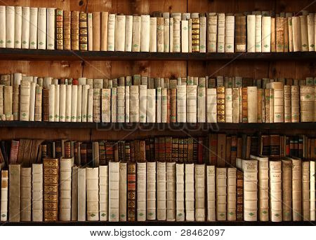 three rows of old books on a shelf