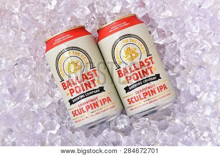 Irvine, Calfornia - February 17, 2019: Two Cnas Of Ballast Point Grapefruit Sculpin Ipa, On A Bed Of