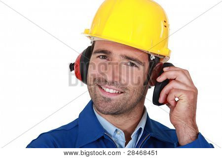Happy builder wearing ear protection