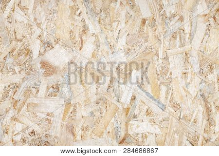 An Abstract Image Of Plywood Board. Texture Of Oriented Strand Board (osb)