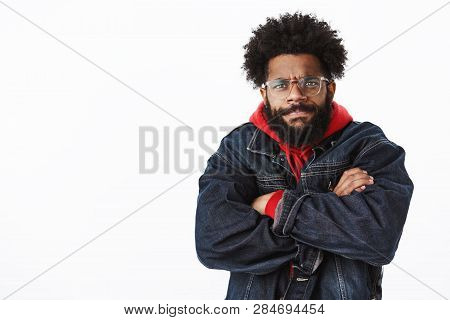 Waist-up Shot Of Intense And Bothered Gloomy Angry African American Bearded Man In Glasses Looking W