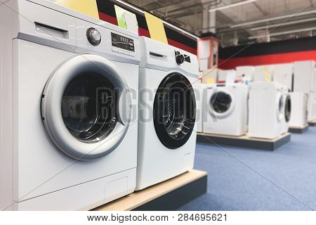 Washing Machines Are In The Household Appliance Store. Choosing And Buying Washing Machines In The E