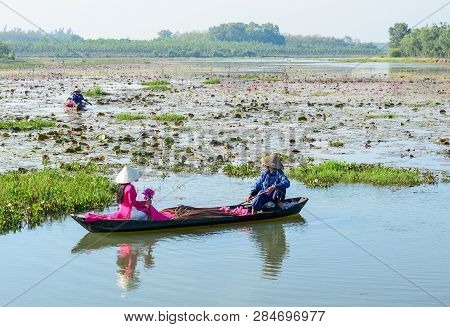 Asian Woman On The Wooden Boat