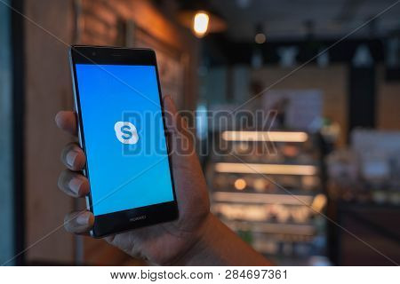 Chiang Mai, Thailand - June 09,2018: Man Holding Huawei With Skype Apps. Skype Is Part Of Microsoft,