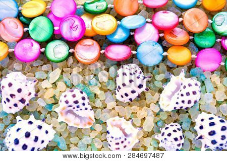 Sea Shells And Colorful Pearl Beads On Crystals Of Aromatic Bath Sea Salt For Spa May Use As Backgro