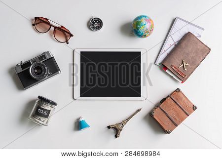 Empty Screen Tablet With Travel Accessories And Items On White Background With Copy Space, Travel Co