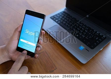 Chiang Mai, Thailand - April 21,2018: Man Holding Huawei With Skype Apps. Skype Is Part Of Microsoft