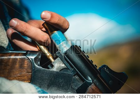 Hunting Licenses. Hunter With Shotgun Gun On Hunt. Hunter In The Fall Hunting Season. Man Is Chargin