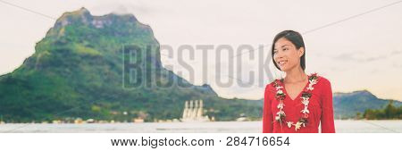 Bora bora French Polynesia Tahiti landscape with mt Otemanu and luxuy cruise ship in background of Asian woman tourist relaxing enjoying honeymoon sunset. Banner panoramic.