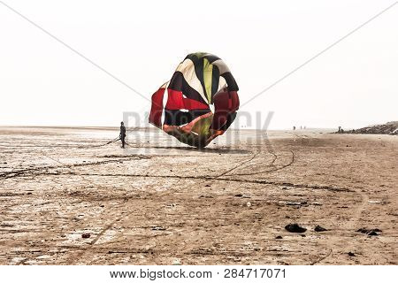 Shadow Of Skydiver With His Parachute Landed Exactly On Target At Anjuna Goa Near Calangute Beach On