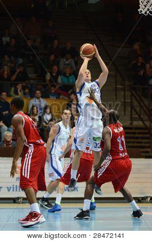 KAPOSVAR, HUNGARY - NOVEMBER 19: Nik Raivio (white 33) in action at a Hugarian National Championship  basketball game Kaposvar (white) vs. Paks (red) November 19, 2011 in Kaposvar, Hungary.