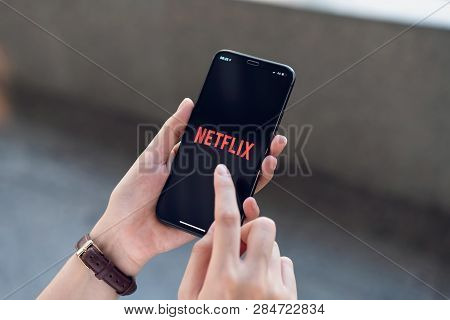 Bangkok, Thailand - March 11, 2019 : Women Use Netflix App On Smartphone Screen. Netflix Is An Inter