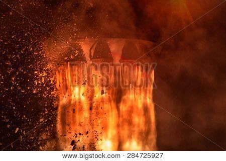 Rocket Engines And Fire Duting The Missile Launch At Night, Close Up Conceptual Image. Elements Of T