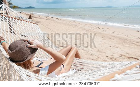Woman On Hammock. Lifestyle Concept. Summer Vacation. Nature Concept. Summer Tourism, Travel. Carefr