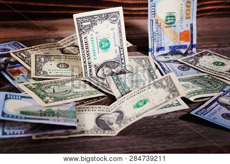 Dollar Bills On The Wooden Table. Financial Background.