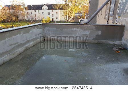 Renovated Balcony With New Concrete Floor And Brick Balcony Railing.