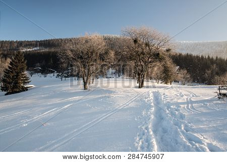 Winter Morning With Snow, Hiking Trail, Few Chalets And Clear Sky On Butoranka Bellow Lysa Hora Hill