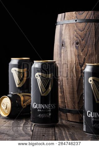 London, Uk - February 06, 2019: Aluminium Cans Of Guinness Draught Stout Beer  Next To Old Wooden Ba