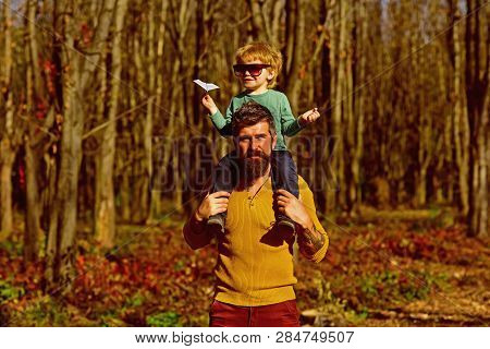 Happy Little Boy Go On Journey On Fathers Shoulder. Journey Into The Country. The World Is Yours To