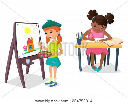 Girl Is Painting A Drawing On The Easel With Paint Palette And Brush In Her Hand. The Other Girl Is