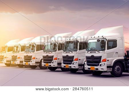 New Truck Fleet Is Parking At Yard During Sunset As For Transportation Service Mode.