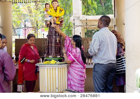 Praying At Statue of Jesus, India