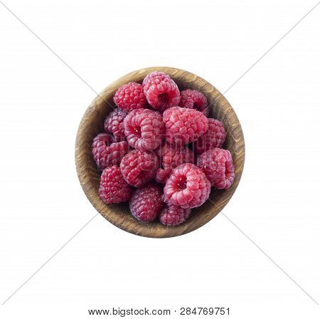 Raspberries In A Wooden Bowl Isolated On White Background. Top View. Raspberry Closeup. Vegetarian O