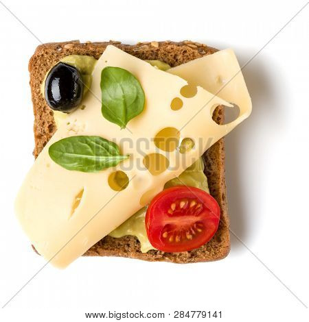Open faced sandwich crostini isolated on white background closeup. Vegetarian canape with cheese. Top view. Flat lay. Appetizer tartarine.
