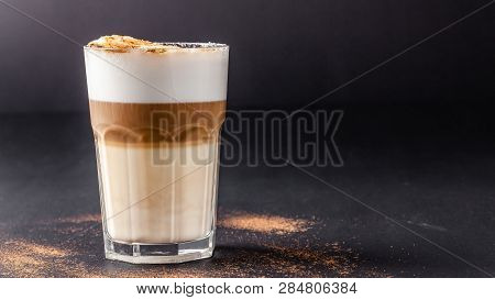 A Modern, Lactose-free Latte Or Cappuccino Coffee With Almond Milk. Above The Fire Sugar Burned Suga