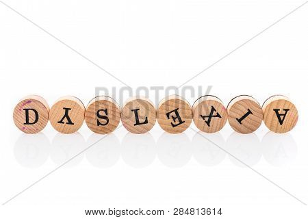 Word Dyslexia From Circular Wooden Tiles With Letters Children Toy.