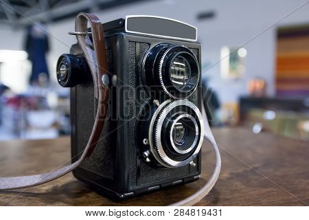 Vintage Twin Lens Camera On The Table.