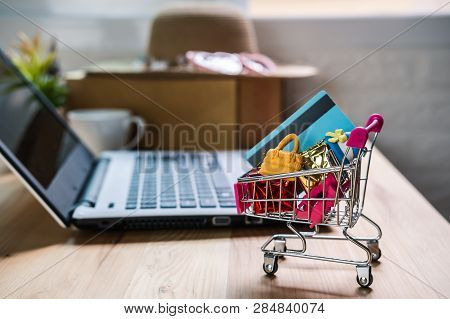 Shopping Cart With Credit Card And Woman Accessories With Laptop, Online Shopping Concept