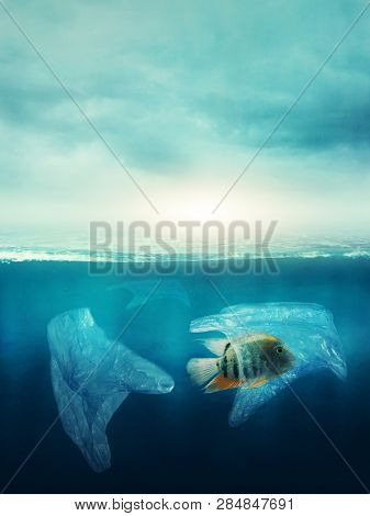 Plastic bag with a fish in the ocean. Pollution concept.