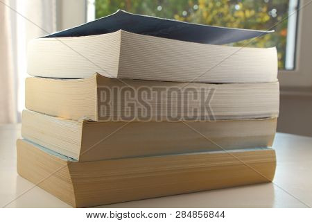 Pile Of Four Paperbacks On A Table