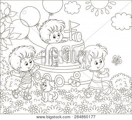 Little Children And A Small Puppy Playing On A Toy Ship On A Playground In A Summer Park, Black And