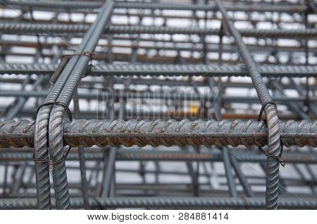 Billets Of Reinforcement At The Construction Site. Construction Of The Building With The Help Of Rei