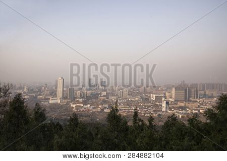 View Of Jinan City From Thousand Buddha Mountain In Autumn Evening, China
