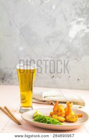 Shrimps Tempura With Lime In Light Plate And Glass Of Beer