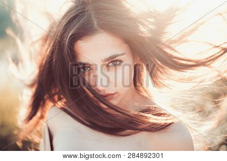 Girl With Nude Shoulders Enjoy Her Hair Waving By Wind. Hair Care Concept.woman On Calm Face Enjoy S