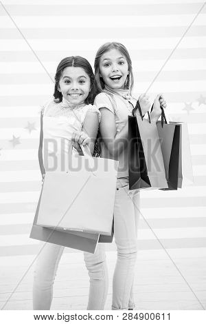 Girls Like Shopping. Kids Happy Small Girls Hold Shopping Bags. Enjoy Shopping With Best Friend Or S