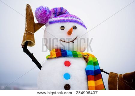 Handmade Snowman In Hat&scarf. New Year Attribute. Christmas Decoration. Cute Snowman In Knitted Hat