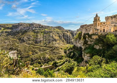 Paths From The Ancient Sassi Caves Cut Down The Mountainside And Into The Canyon In Matera, Italy, A