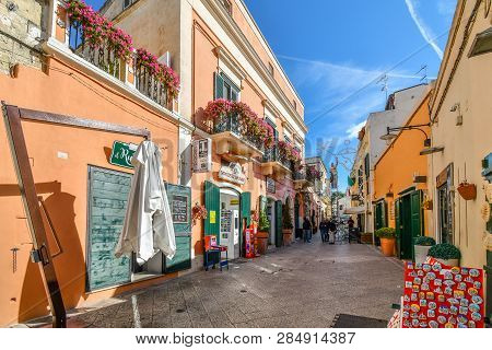 Matera, Italy - September 24 2018: A Worker Adds Decorations On The Shop And Cafe Filled Via San Bia