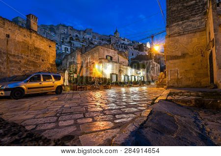 Matera, Italy - September 28 2018: Night View, Street Level Of An Illuminated Cafe In The Historic,