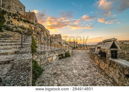 The Ancient Stone Path Around The Prehistoric City Of Matera, Italy, With The Sassi And Convent Of S