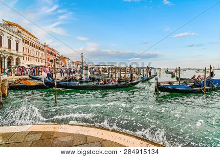 Venice, Italy - September 18 2018: Tourists Fill The Gondolas At The Grand Canal Gondola Station As
