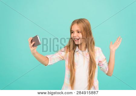 Hello World This Is My Channel. Let Me Take Selfie. Child Girl Hold Smartphone. Video Call Concept.