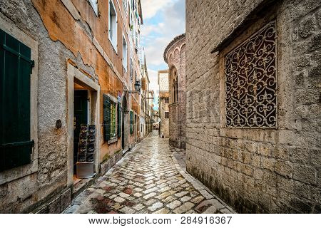Kotor, Montenegro - September 19 2018: Small Shops And Cafes Line A Picturesque Medieval Street In T