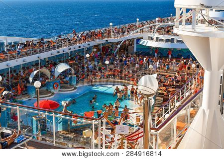 Athens, Greece - September 18 2018: Tourists Lounge In The Sun, Swim And Party On The Upper Deck Of