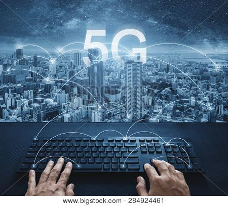 5g Internet Networking Technology, Hand Typing On Computer Keyboard With City And 5g Internet Connec